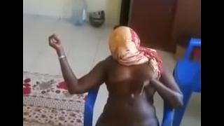 girl from Senegal striping for boyfriend
